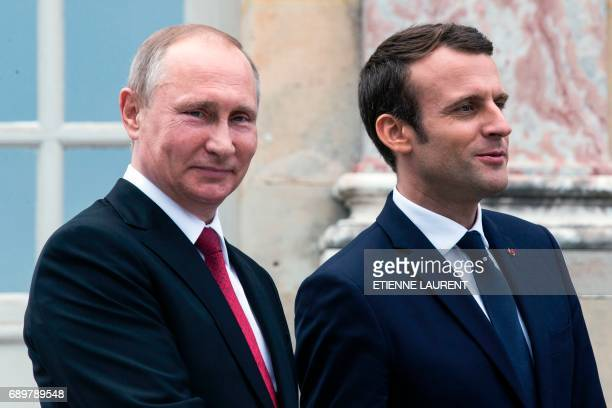 French President Emmanuel Macron and his Russian counterpart President Vladimir Putin visit an exhibition about Russian emperor Peter the Great at...