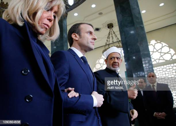 French President Emmanuel Macron and his wife Brigitte are welcomed by Ahmed alTayeb the Grand Imam of AlAzhar the most prestigious seat of Sunni...