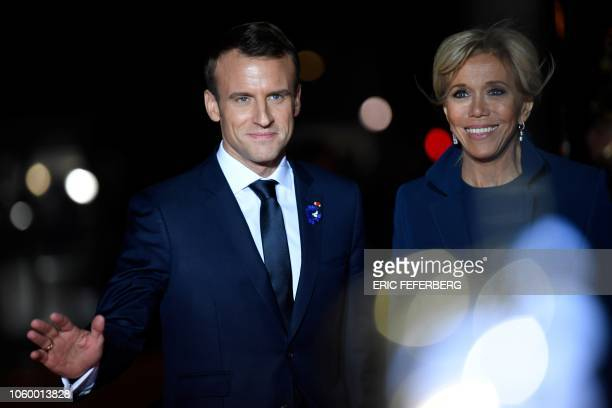 French President Emmanuel Macron and his wife Brigitte arrive at the Musee d'Orsay in Paris on November 10, 2018 to attend a state diner and a visit...