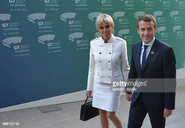 French President Emmanuel Macron and his wife Brigitte arrive for a concert of La Scala Philharmonic Orchestra at the ancient Greek Theatre of...