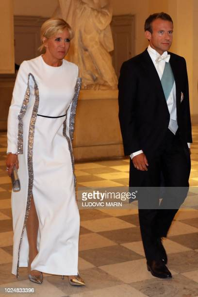 French President Emmanuel Macron and his wife Brigitte arrive for the state dinner at Christiansborg Palace in Copenhagen on August 28 2018
