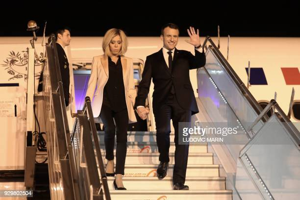 French President Emmanuel Macron and his wife Brigitte arrive on March 9, 2018 at New Delhi's military airport for a three-day visit in the country....