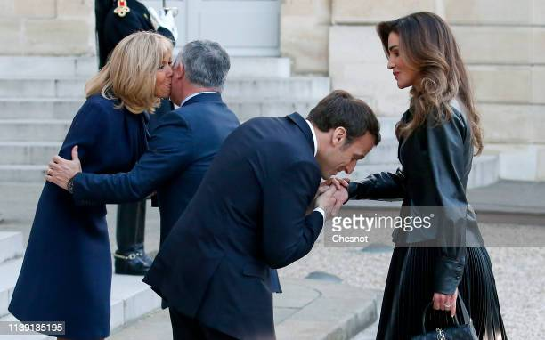 French President Emmanuel Macron and his wife Brigitte greet King Abdullah II of Jordan and his wife Queen Rania prior to a meeting at the Elysee...