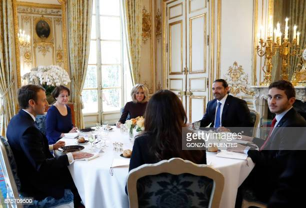 French President Emmanuel Macron and his wife Brigitte host a lunch with Saad Hariri who announced his resignation as Lebanon's Prime Minister while...