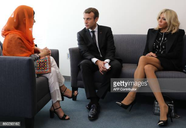 French President Emmanuel Macron and his wife Brigitte listen to Pakistani activist Malala Yousafzaion during their meeting on September 20 in New...
