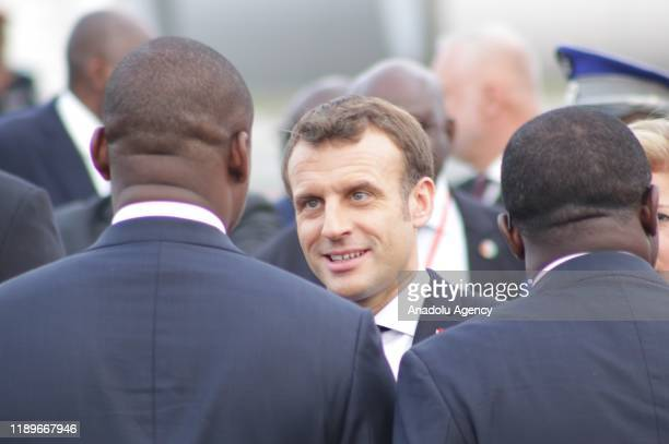 French President Emmanuel Macron and his wife Brigitte Macron are being welcomed by President of Ivory Coast Alassane Ouattara and his wife Dominique...