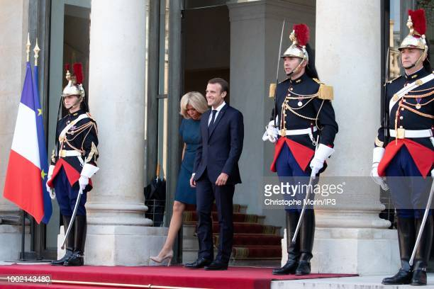 French president Emmanuel Macron and his wife Brigitte Macron arrive before a reception for the French national football team after they won the...