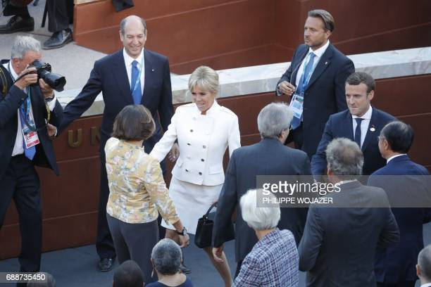 French President Emmanuel Macron and his wife Brigitte Macron arrive to attend a concert of the La Scala Philharmonic Orchestra during the Summit of...