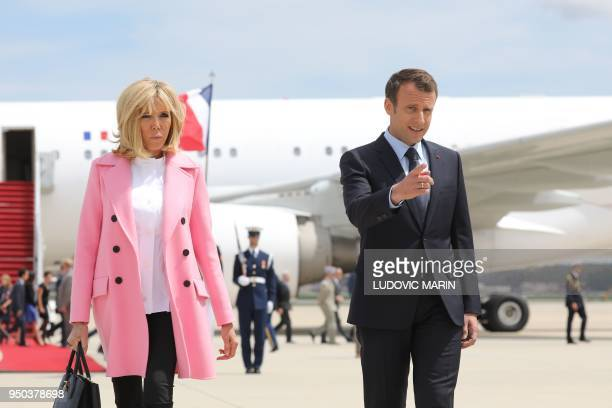 French President Emmanuel Macron and his wife Brigitte Macron arrive at Joint Base Andrews in Maryland on April 23, 2018. - President Macron is in...
