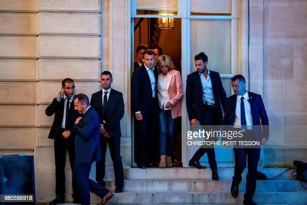 French president Emmanuel Macron and his wife Brigitte Macron arrive to attend the annual 'Fete de la Musique' in the courtyard of the Elysee Palace...