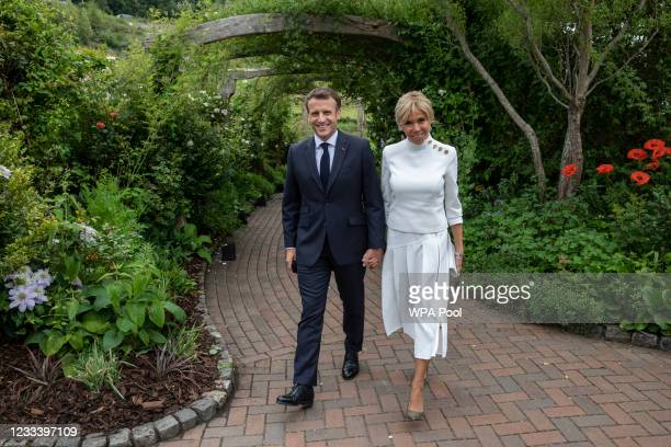 French President Emmanuel Macron and his wife Brigitte Macron attend a drinks reception for Queen Elizabeth II and G7 leaders at The Eden Project...