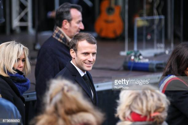 French President Emmanuel Macron and his wife Brigitte Macron attend a ceremony at Paris 11th district town hall France November 13 during ceremonies...
