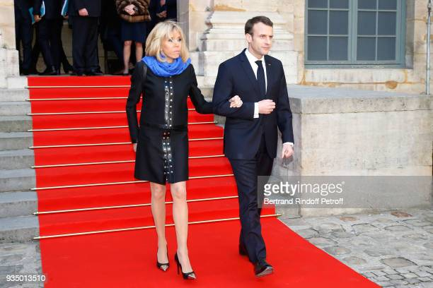French President Emmanuel Macron and his wife Brigitte Macron attend the French Academy visit by GrandDuc Henri and GrandeDuchesse Maria Teresa of...
