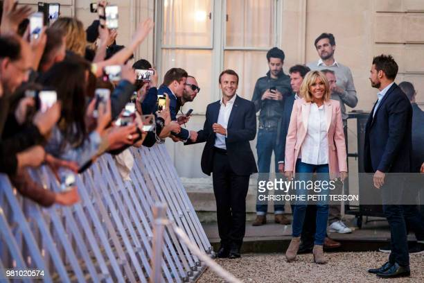 French President Emmanuel Macron and his wife Brigitte Macron attend the 'Fete de la Musique' the music day celebration in the courtyard of the...