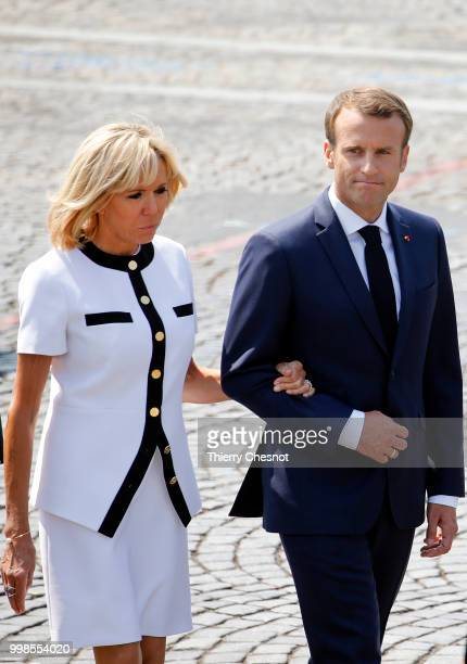 French President Emmanuel Macron and his wife Brigitte Macron attend the traditional Bastille Day military parade on the ChampsElysees on July 14...
