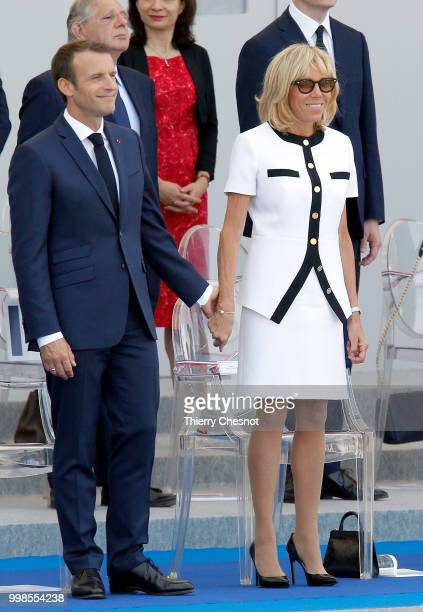 French President Emmanuel Macron and his wife Brigitte Macron attend the traditional Bastille Day military parade on the Champs-Elysees on July 14,...