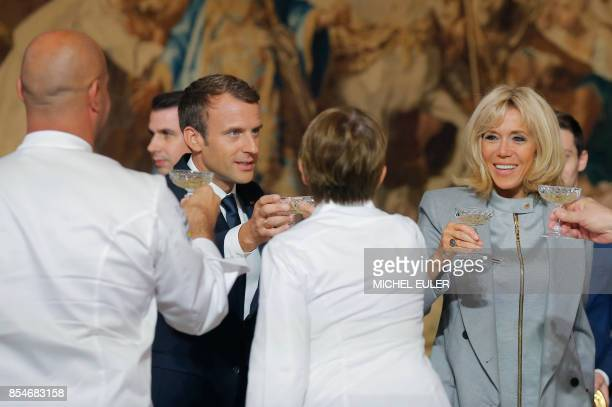 French President Emmanuel Macron and his wife Brigitte Macron drink a toast to invited chefs during an event at the Elysee Palace in Paris on...