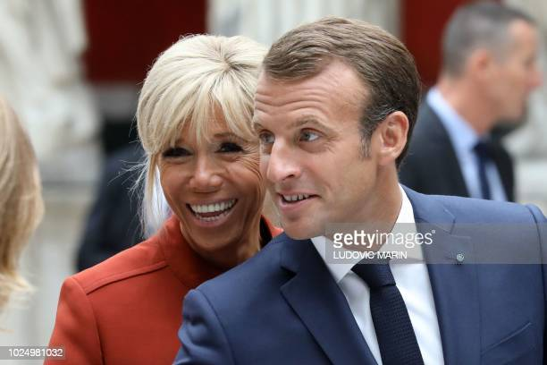 French President Emmanuel Macron and his wife Brigitte Macron greet people during a visit at the Ny Carlsberg Glyptotek museum on August 29 2018 in...