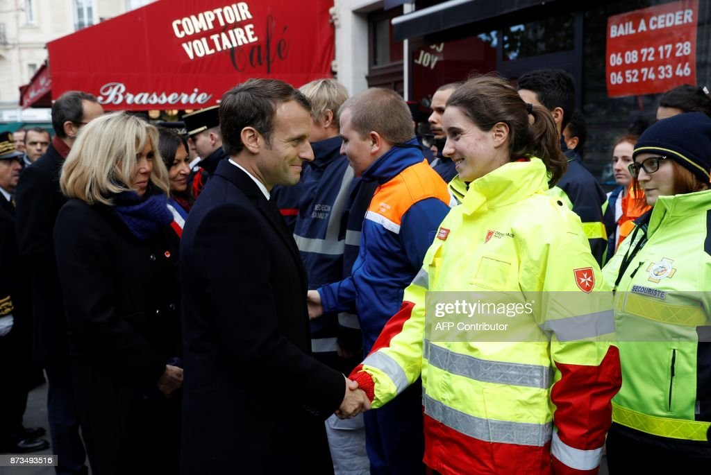 French president emmanuel macron 2l and his wife brigitte macron french president emmanuel macron 2l and his wife brigitte macron l greet m4hsunfo Gallery