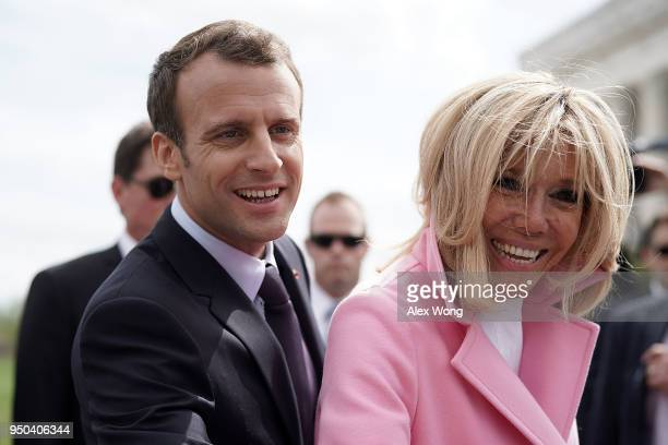 French President Emmanuel Macron and his wife Brigitte Macron greet members of the public at the Lincoln Memorial April 23 2018 in Washington DC...