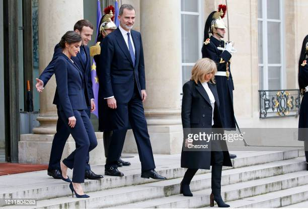 French President Emmanuel Macron and his wife Brigitte Macron accompany King Felipe of Spain and Queen Letizia of Spain after a lunch at the Elysee...