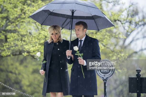 French President Emmanuel Macron and his wife Brigitte Macron lay roses on the gravesites of former President John F Kennedy and Jacqueline Bouvier...