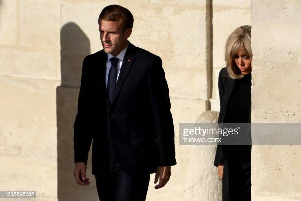 French President Emmanuel Macron and his wife Brigitte Macron leave the national memorial service for Hubert Germain - the last surviving Liberation...