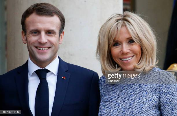 French President Emmanuel Macron and his wife Brigitte Macron accompany Romanian President Klaus Iohannis and his Carmen Iohannis after their meeting...