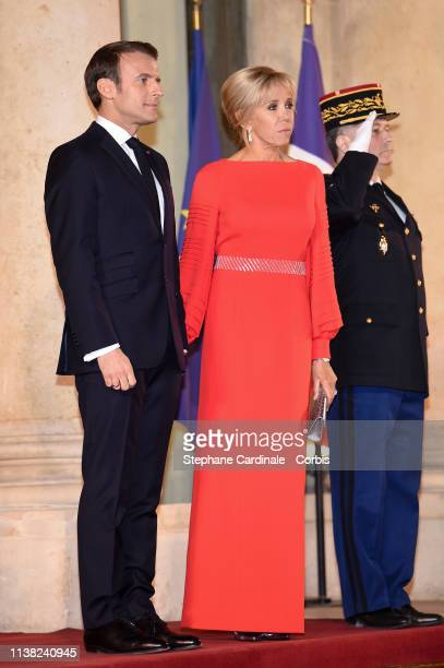 French President Emmanuel Macron and his wife Brigitte Macron pose prior to a state dinner with Chinese President Xi Jinping at the Elysee...