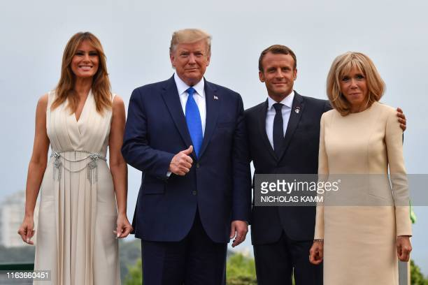 French President Emmanuel Macron and his wife Brigitte Macron pose with US President Donald Trump and US First Lady Melania Trump at the Biarritz...