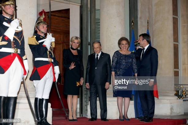 French President Emmanuel Macron and his wife Brigitte Macron pose with Lebanese President Michel Aoun and his wife Nadia Aoun prior to a state...