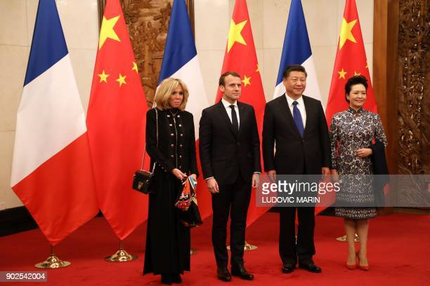 French President Emmanuel Macron and his wife Brigitte Macron pose with Chinese President Xi Jinping and his wife Peng Liyuan at the Diaoyutai State...