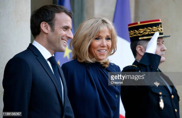 French President Emmanuel Macron and his wife Brigitte Macron prepare to greet King Abdullah II of Jordan and his wife Queen Rania prior to a meeting...