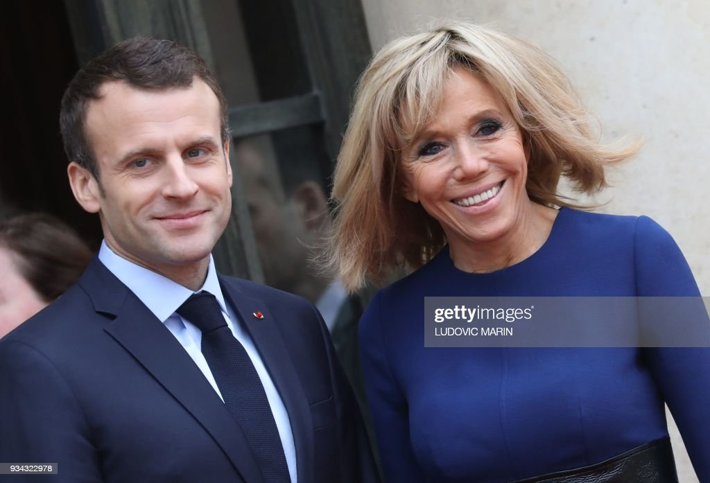 TOPSHOT - French President Emmanuel Macron and his wife Brigitte Macron smile after a meeting with Grand Duke and Duchess of Luxembourg at the Elysee palace in Paris on March 19, 2018. /