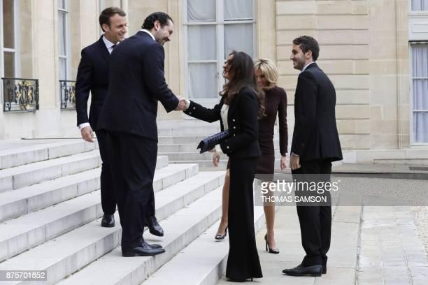 French President Emmanuel Macron and his wife Brigitte Macron stand next to Lebanese Prime Minister Saad Hariri his wife Lara Bachir ElAlzm and their...