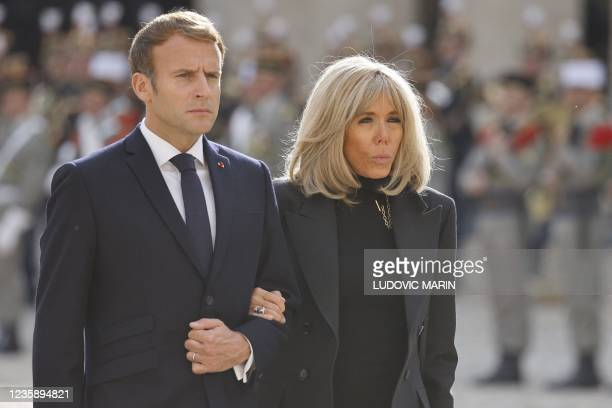 French President Emmanuel Macron and his wife Brigitte Macron take part in a national memorial service for Hubert Germain - the last surviving...