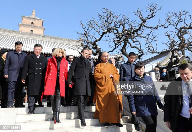 French President Emmanuel Macron and his wife Brigitte Macron tour around Big Wild Goose Pagoda during a visit to the northern Chinese city of Xian...