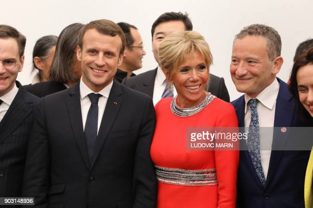French President Emmanuel Macron and his wife Brigitte Macron visit the Ullens Chinese Contemporary Art Centre in Beijing on January 9 2018 Macron is...