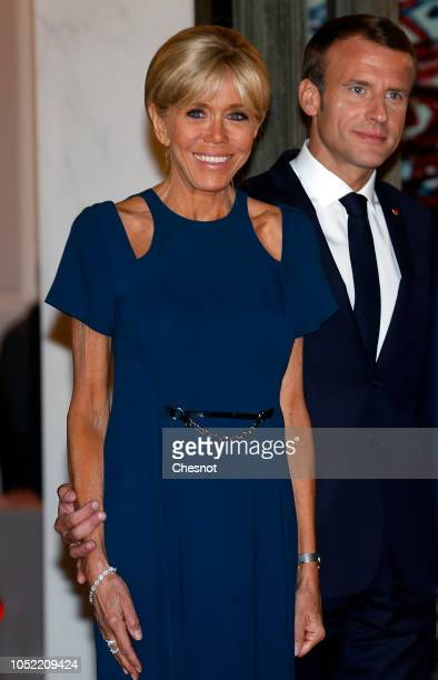 French President Emmanuel Macron and his wife Brigitte Macron wait for South Korean President Moon Jaein and his wife Kim Jungsook prior to a state...