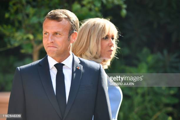 French President Emmanuel Macron and his wife Brigitte Macron wait for the arrival of the Russian President at the French President' summer retreat...
