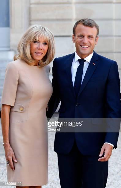 French President Emmanuel Macron and his wife Brigitte Macron wait for Greek Prime Minister Kyriakos Mitsotakis and his wife Mareva Grabowski prior...