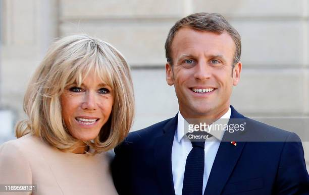 French President Emmanuel Macron and his wife Brigitte Macron wait for Greek Prime Minister Kyriakos Mitsotakis and his wife Mareva Grabowski prior...