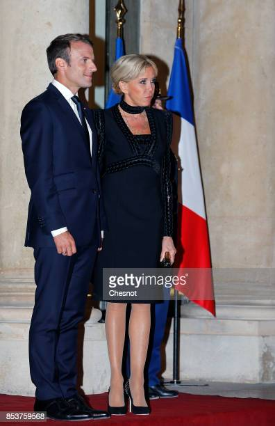 French President Emmanuel Macron and his wife Brigitte Macron wait prior to a state dinner with Lebanese President Michel Aoun and his wife Nadia...