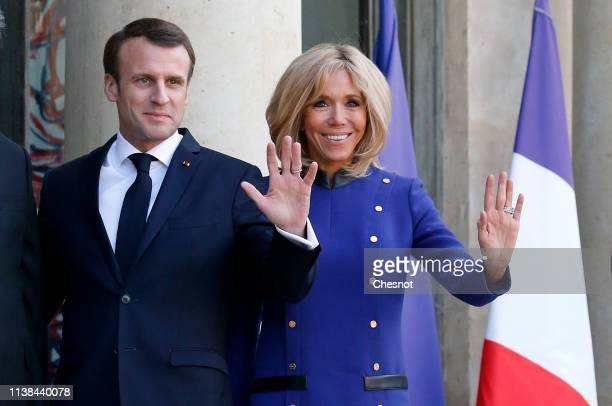 French President Emmanuel Macron and his wife Brigitte Macron wave as Chinese President Xi Jinping and his wife Peng Liyuan leave after their meeting...
