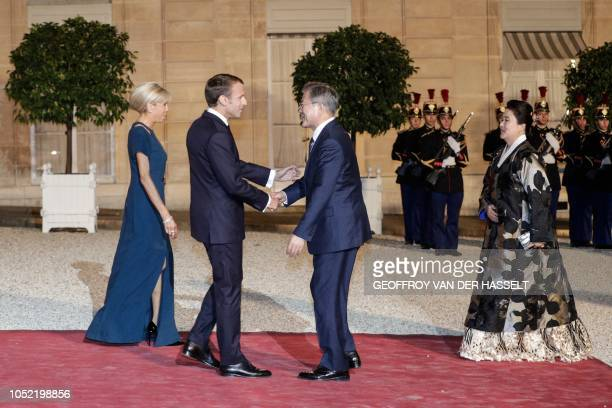 French President Emmanuel Macron and his wife Brigitte Macron welcome South Korean President Moon Jae-in and his wife Kim Jung-sook upon their...