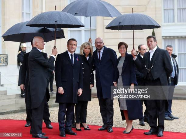 French President Emmanuel Macron and his wife Brigitte Macron welcome Belgian Prime Minister Charles Michel and his partner Belgian Prime Minister's...