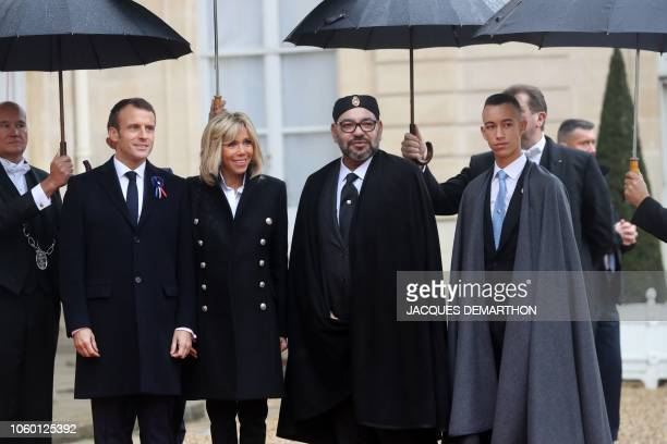 French President Emmanuel Macron and his wife Brigitte Macron welcome Moroccan King Mohammed VI and his son Morocco's Prince Moulay Hassan as they...
