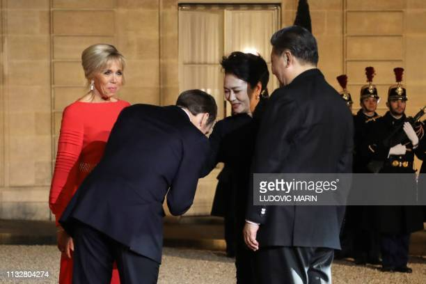 French President Emmanuel Macron , and his wife Brigitte Macron welcome Chinese President Xi Jinping and his wife Peng Liyuan as they arrive to...