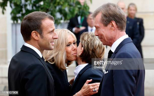 French President Emmanuel Macron and his wife Brigitte Macron welcome Grand Duc Henri of Luxembourg and Grand Duchess Maria Teresa of Luxembourg...