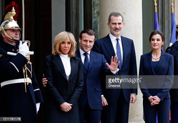 French President Emmanuel Macron and his wife Brigitte Macron welcome King Felipe of Spain and Queen Letizia of Spain prior to a lunch at the Elysee...